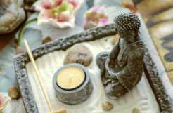 Buddha statue in zen sand garden.