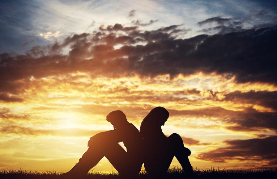 Sad couple disagrees in the evening twilight.
