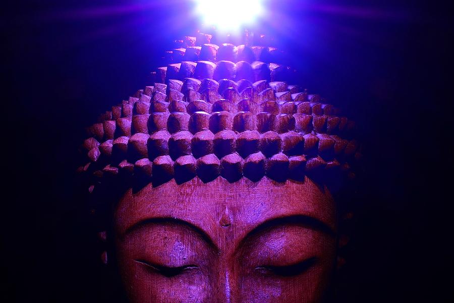 Buddha illuminated by the Crown Chakra