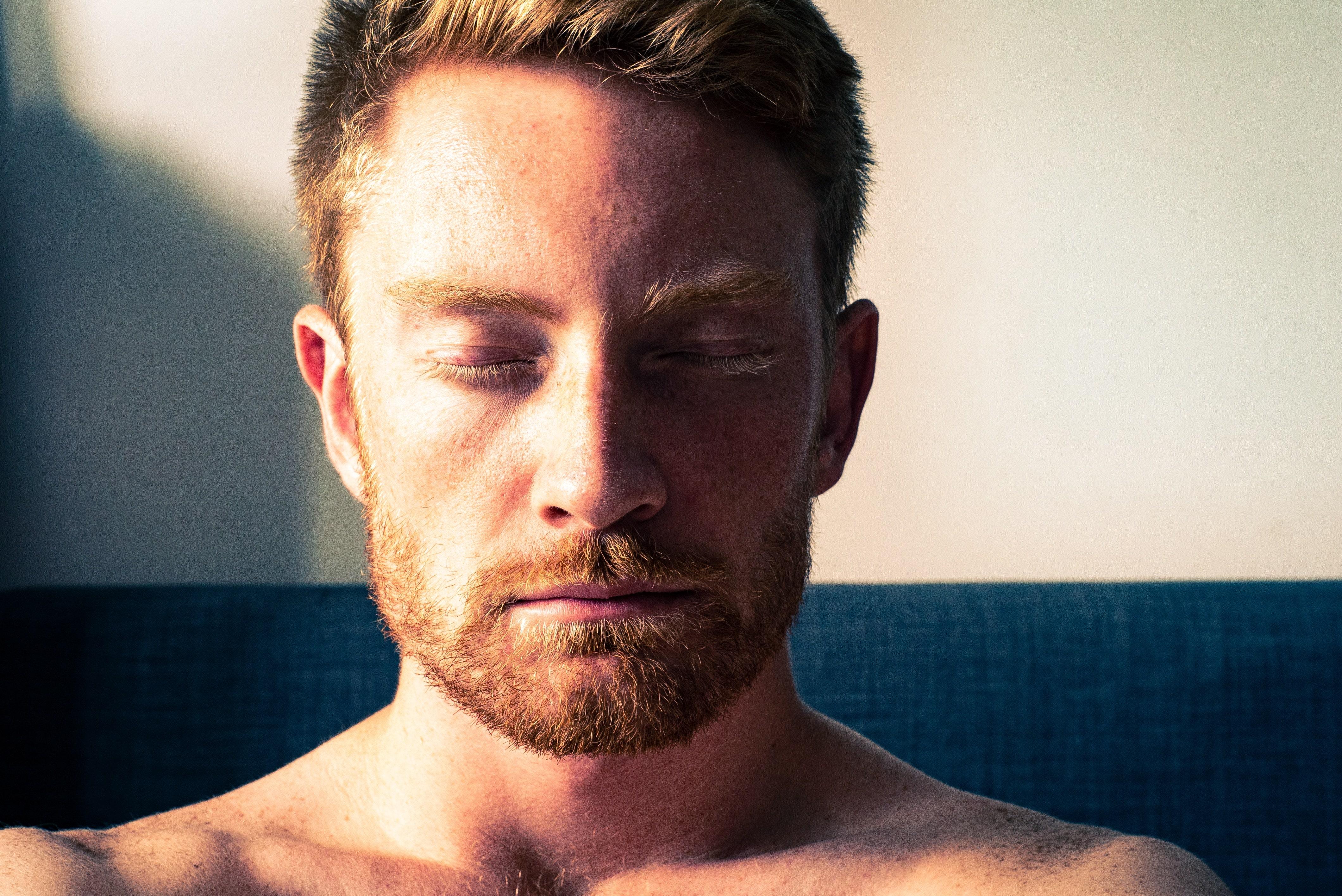 Closeup of bearded man meditating.